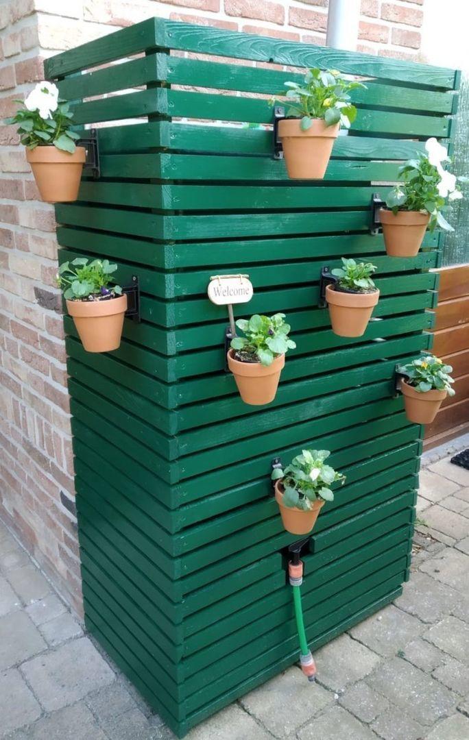 Groene muur regenton met ombouw